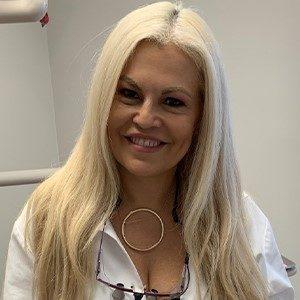 Smiling Dr. Virginia Miller Graicerstein, dentist in Torrington