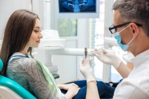 Patient wondering if dental implants are worth the cost